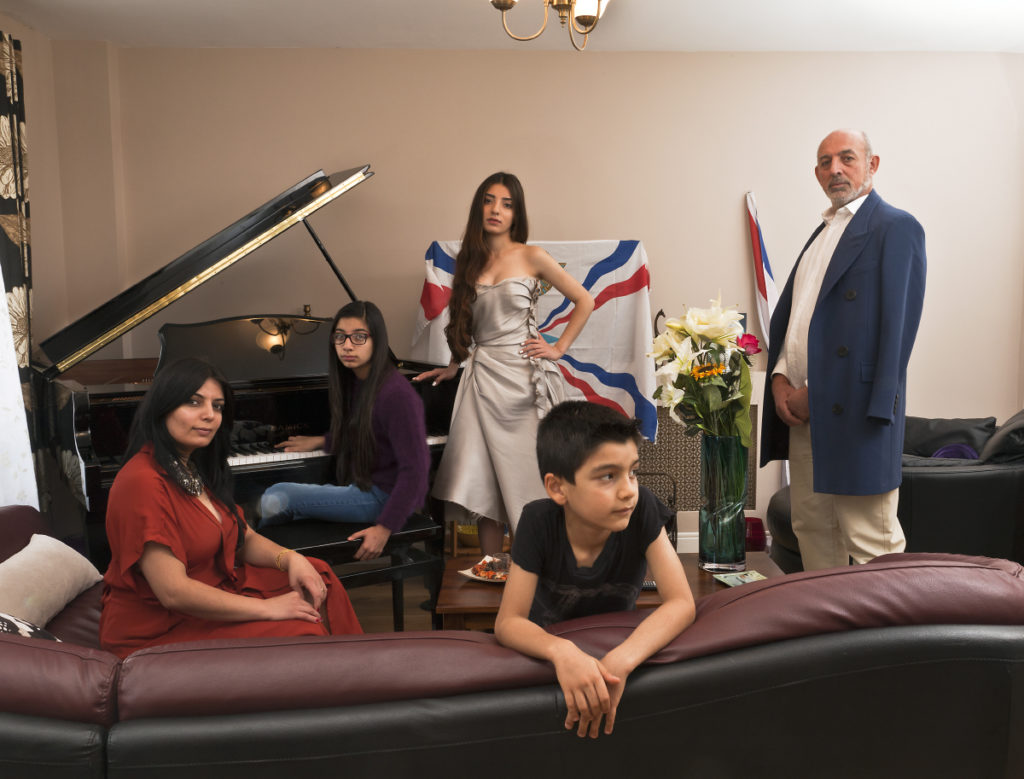 New British. Iraqi/Syrian David family living in Wembly, London. Fater, Samir David, mother Nahrin, son, Nishra'd' Atour, daughter at piano, Ninweh and daughter Noora.
