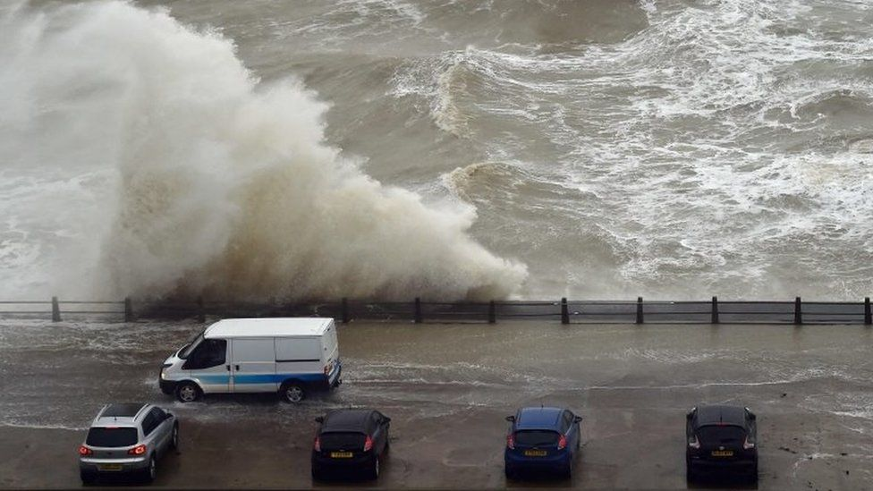 Waves crash over the wall at Newhaven Harbour, East Sussex